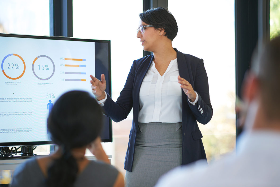 woman giving sales presentation outline